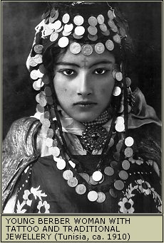 Berber Woman from around 1910 dressed in tribal jewelry